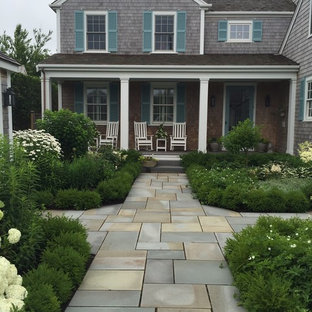 Design ideas for a small coastal partial sun front yard stone landscaping in Miami for summer.