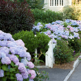 Inspiration for a mid-sized traditional full sun front yard stone landscaping in New York for spring.
