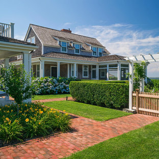 This Is An Example Of An Expansive Nautical Back Full Sun Garden In Boston  With Brick