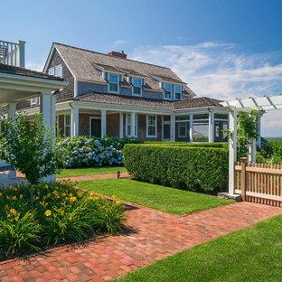 Design ideas for a huge beach style full sun backyard brick garden path in Boston.