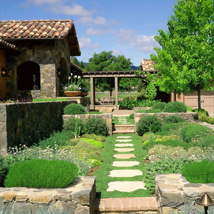 Design ideas for a mediterranean front yard stone landscaping in San Francisco.