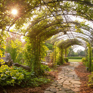 This is an example of a large traditional shade stone garden path in Chicago.