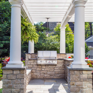 This is an example of a mid-sized contemporary full sun backyard stone landscaping in Chicago for summer.