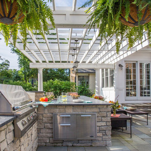 This is an example of a mid-sized contemporary full sun backyard stone landscaping in Chicago with a fire pit for summer.