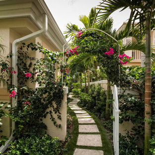 Inspiration for a tropical shaded garden in Miami with a garden path and concrete pavers.