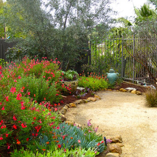 This is an example of a mediterranean backyard gravel landscaping in Los Angeles.