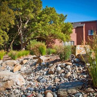 Photo of a mediterranean backyard garden in San Luis Obispo with gravel.