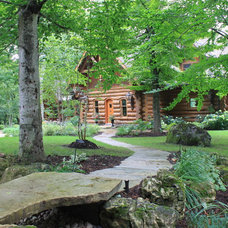 Rustic Landscape by Hill' N Dale Landscaping
