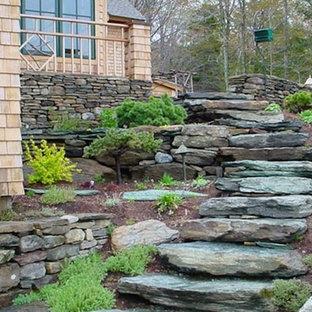 Inspiration for a large craftsman full sun backyard stone landscaping in Burlington.