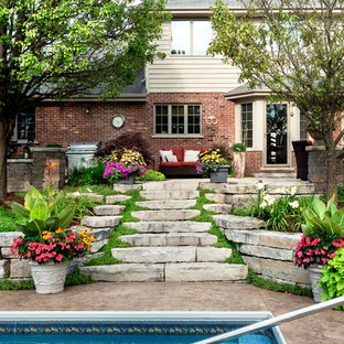 Inspiration for a medium sized classic back full sun garden for summer in Chicago with a retaining wall and natural stone paving.
