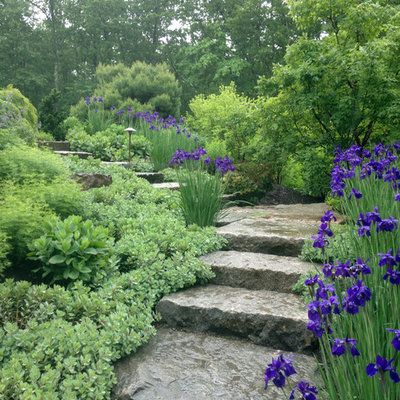 This is an example of a mid-sized rustic full sun front yard stone landscaping in Boston for spring.