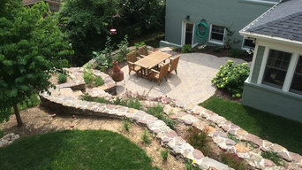 Natural stone terraced backyard with paver patio
