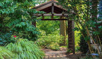 Naturalistic back yard landscaping with arbor