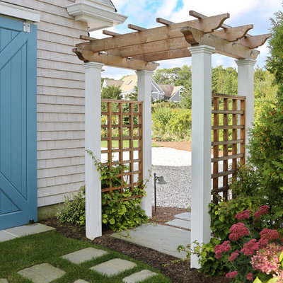 This is an example of a farmhouse shade side yard garden path in Boston.