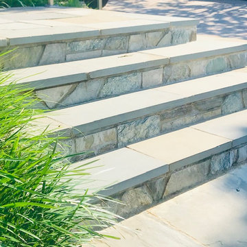 New Driveway with retaining wall and walkway with steps with landings - Stunning