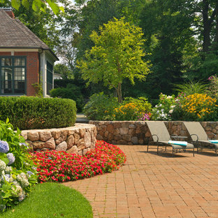 Inspiration for a large timeless backyard brick patio remodel in Boston