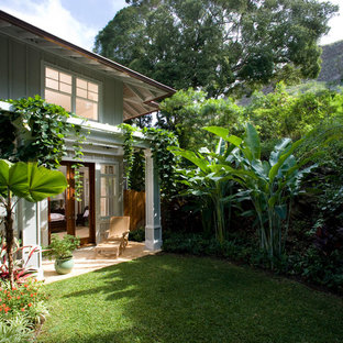 Photo of a small tropical partial sun backyard landscaping in Hawaii.