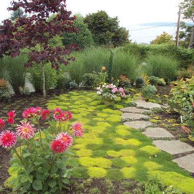 This is an example of an eclectic backyard stone landscaping in Seattle for summer.