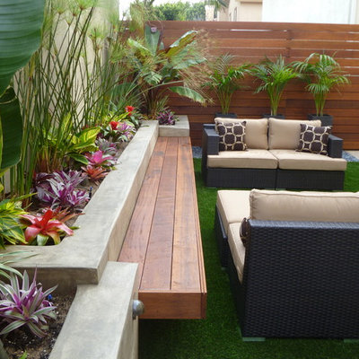 Inspiration for a small contemporary shade backyard water fountain landscape in Los Angeles.