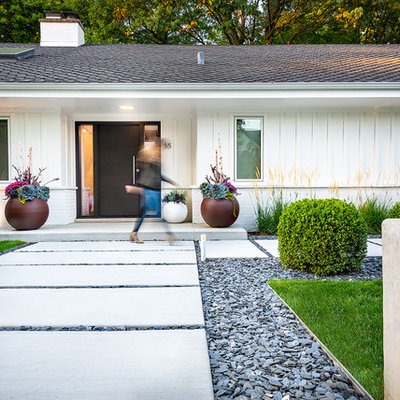 Photo of a mid-sized contemporary front yard concrete paver garden path in Chicago.