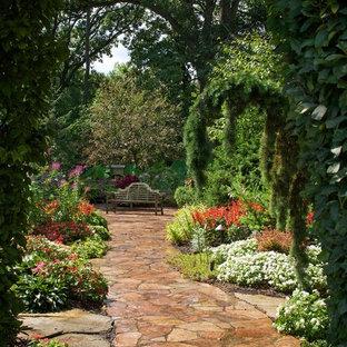 Inspiration for a huge contemporary partial sun backyard stone garden path in Chicago for summer.