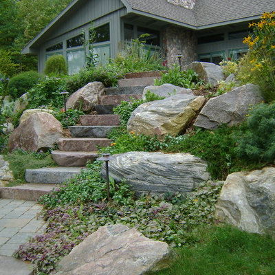 This is an example of a traditional hillside stone landscaping in Other.