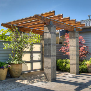 This is an example of a contemporary drought-tolerant and partial sun front yard concrete paver garden path in Seattle for summer.