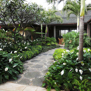 Photo Of A Mid Sized Tropical Shade Courtyard Stone Landscaping In Hawaii