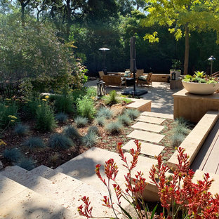 Design ideas for a huge mediterranean drought-tolerant and full sun backyard stone retaining wall landscape in San Francisco for summer.