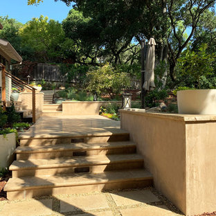 Photo of a huge contemporary full sun and drought-tolerant backyard stone retaining wall landscape in San Francisco for fall.