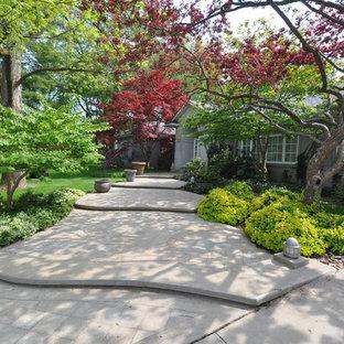 Medium sized classic front partial sun garden in Toronto.