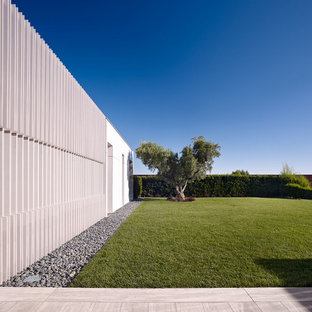 This is an example of a contemporary backyard stone landscaping in Los Angeles.