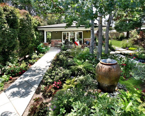 Captivating Inspiration For A Large Traditional Partial Sun Backyard Concrete Paver  Landscaping In Orange County.
