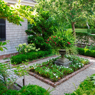 This is an example of a mid-sized victorian shade side yard gravel formal garden in Boston.