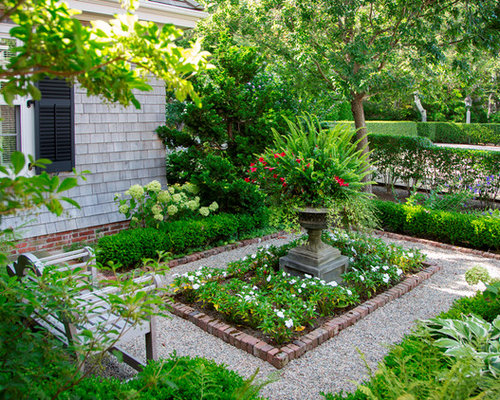 This is an example of a mid-sized victorian shade side yard gravel formal  garden - Victorian Landscaping Ideas & Design Photos Houzz