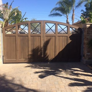 Photo of a large beach style partial sun front yard brick driveway in Los Angeles.