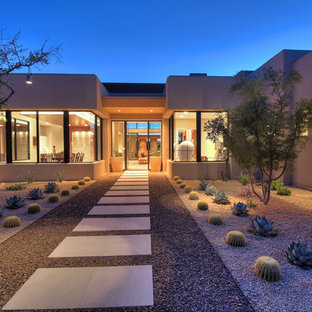 Contemporary xeriscape full sun garden in Other with a garden path and gravel.