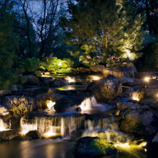 Design ideas for a large traditional partial sun backyard stone landscaping in Chicago.