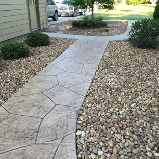 Photo of a mid-sized traditional partial sun side yard concrete paver garden path in Houston.