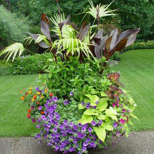 Photo of an eclectic backyard partial sun garden for summer in Chicago with a container garden.