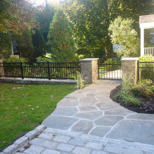 Photo of a large traditional drought-tolerant and partial sun backyard concrete paver garden path in New York for summer.