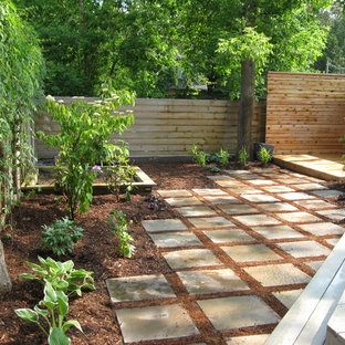 Design ideas for a modern water fountain landscape in Toronto with decking.