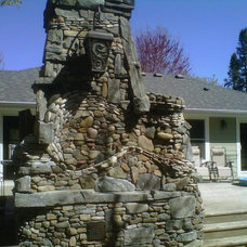 Traditional Landscape by Peterson Masonry Design
