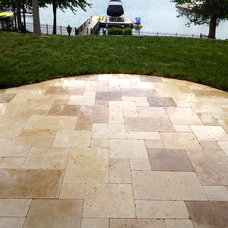 Traditional Landscape by Sunmar Construction