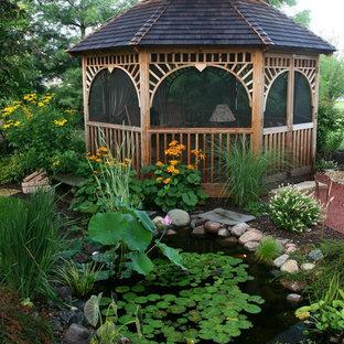 Inspiration för en tropisk trädgård, med en fontän