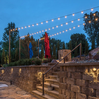 This is an example of a rustic backyard retaining wall landscape in Omaha.