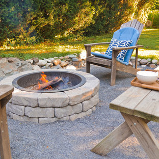 Photo of a small coastal backyard landscaping in Boston with a fire pit.