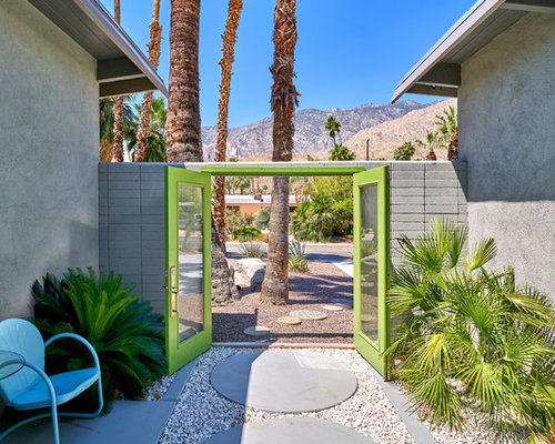 inspiration for a mid sized midcentury partial sun landscape in other with a garden path - Mid Century Home Design