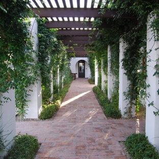 Design ideas for a mediterranean brick landscaping in Phoenix.