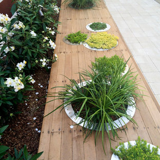 Inspiration for a small modern full sun backyard concrete paver landscaping in San Francisco.